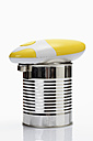 Tin with electric can opener on white background - CSF015489