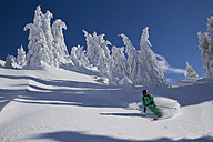 Austria, Tirol, Kitzbuehel, Man doing telemark Skiing - FFF001250