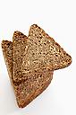 Multigrain rye bread slices on white background - CSF015498