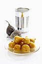 Preserved fig in plate and tin can on white background - CSF015525