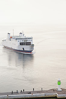 Denmark, Aarhus, View of entering ferryboat at harbour entrance with lighthouse - MSF002574