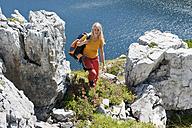 Austria, Salzburg, Hiker walking between rock - HHF003773