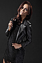 Young woman in black dress and leather jacket, portrait - MAEF004123