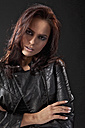 Young woman in black dress and leather jacket, portrait - MAEF004133