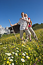 Austria, Salzburg, Filzmoos, Couple standing in alpine meadow - HHF003816