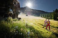 Austria, Salzburg, Filzmoos, Couple looking at alpine hut - HHF003808