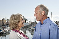 Spain, Mallorca, Palma, Senior couple at harbour, smiling - SKF000820