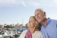 Spain, Mallorca, Palma, Senior couple at harbour, smiling - SKF000823