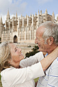 Spain, Mallorca, Palma, Senior couple smiling with Cathedral Santa Maria, portrait - SKF000865