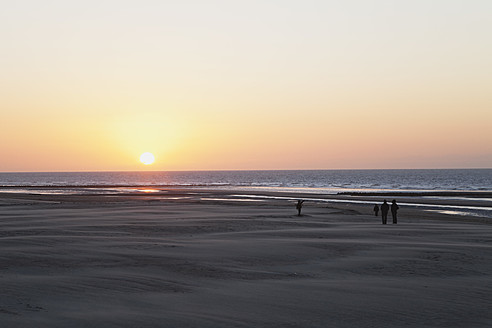 Belgium, Flanders, People on beach at sunset - GW001661