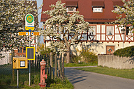 Germany, View of busstop with framehouse in background - SH000627