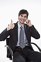 Businessman using cell phone, smiling, portrait - MAEF004240