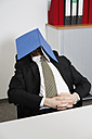 Germany, Businessman sleeping with file on face - ANBF000070