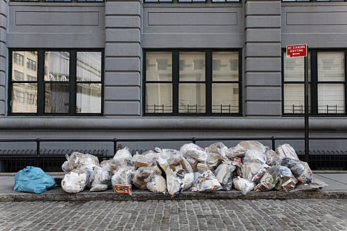 USA, New York, Piled garbage bags on street - ANB000052