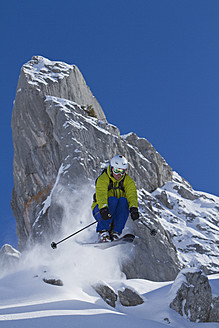 Austria, Arlberg, Warth, Mid adult man skiing - FFF001257