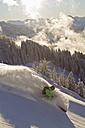 Austria, Tyrol, Kitzbuhel, Mid adult man skiing - FFF001264