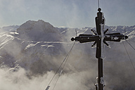 Austria, Tyrol, Kitzbuhel, View of cross with mountains in background - FFF001272