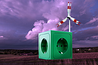 Green socket on landscape in front of windmill - CSF015766