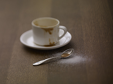 Coffee cup with saucer and spoon on table, close up - SRSF000218