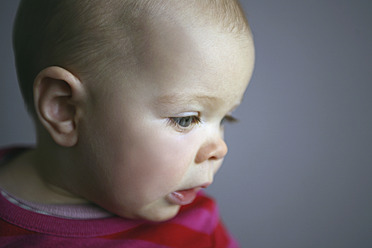 Baby girl looking down, close up - SAF000007