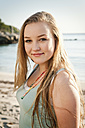 Spain, Mallorca, Teenage girl on beach, smiling, portrait - MFPF000002