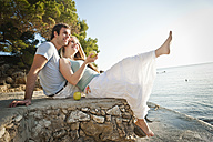 Spain, Mallorca, Couple sitting on beach, smiling - MFPF000008