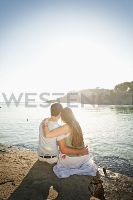 Spain, Mallorca, Couple sitting on beach - MFPF000011