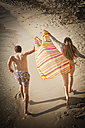 Spain, Mallorca, Couple running along beach - MFPF000026