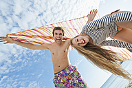 Spain, Mallorca, Couple on beach, smiling, portrait - MFPF000029
