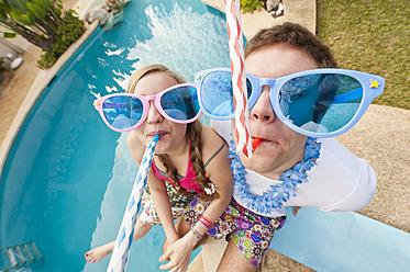 Spain, Mallorca, Couple playing on swimming pool - MFPF000053