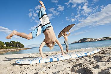 Spain, Mallorca, Children playing on beach - MFPF000077