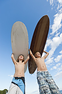 Spain, Mallorca, Children with surfboard on beach - MFPF000080