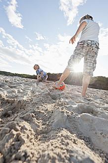 Spain, Mallorca, Children playing soccer on beach - MFPF000086