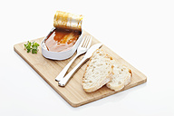 Herring fillets with tomato sauce in tin on chopping board - MAEF004396