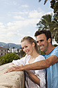 Spain, Mallorca, Palma, Couple looking away, smiling - SKF000928