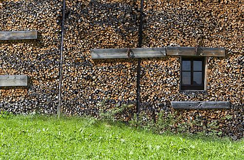 Austria, Tyrol, View of farm house with fire wood - WWF001948