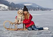 Austria, Teenage girl with dog, smiling, portrait - WWF002287