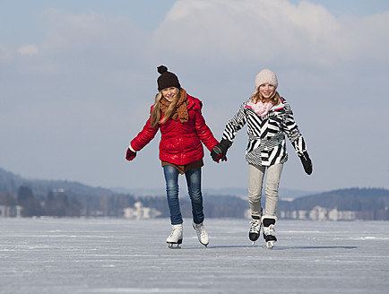 Austria, Teenage girls doing ice skating - WWF002295