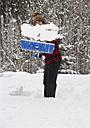 Austria, Young man shoveling snow, portrait - WWF002123