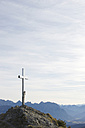 Germany, Bavaria, View of summit cross with mountains - MIRF000358