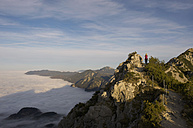 Germany, Bavaria, Walchensee Region, Hiker on mountain - MIRF000364
