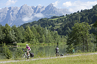 Austria, Salzburger Land, Mid adult woman riding bicycle - DS000257