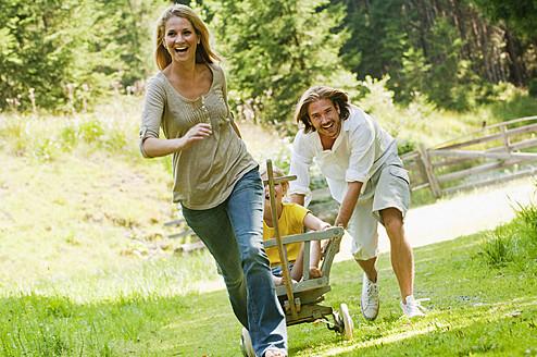 Austria, Salzburg County , Family with rack wagon - HHF003985