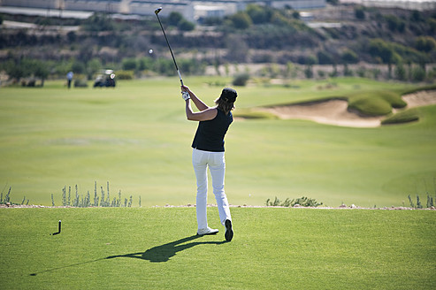 Cyprus, Woman playing golf on golf course - GNF001214