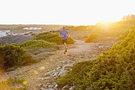 Portugal,Algarve,  Mature man jogging by coast - MIRF000371