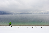 Germany, Mature man jogging by Walchensee Lake - MIRF000377