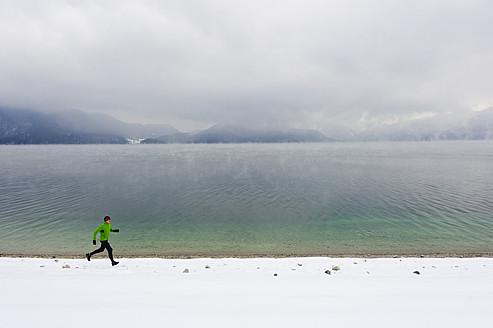 Germany, Mature man jogging by Walchensee Lake - MIRF000377