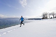 Germany, Mature man jogging by Walchensee Lake - MIRF000380