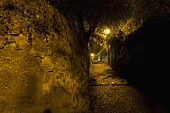 Italy, Torbole, View of cave at night - MIRF000386