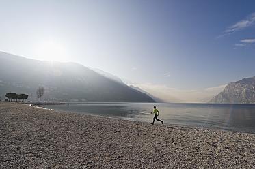 Italy, Mature man jogging by Lake Garda - MIRF000392